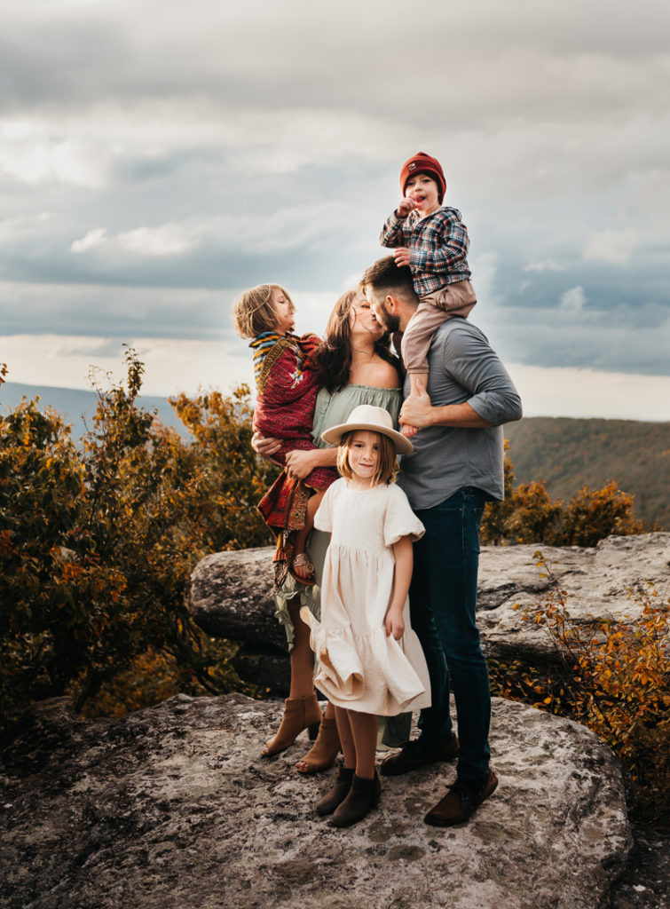 Virginia Family Photographer, family posing together on top of a mountain